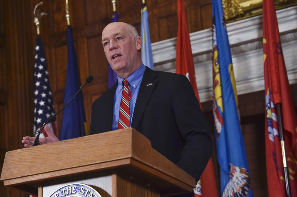 "FILE - In this Jan. 5, 2021 file photo Montana Gov. Greg Gianforte speaks to members of the press in the Governor's Reception Room of the Montana State Capitol in Helena, Mont. Montana House lawmakers voted Monday, Jan. 25, 2021, to advance four bills that would restrict abortion access in the state, hoping to capitalize on the election of a Republican governor after 16 years of pro-abortion access Democratic governors in the state. Gianforte has promised to ""defend life,"" giving anti-abortion lawmakers and activists hope that the bills will be signed into law. (Thom Bridge/Independent Record via AP, File)"
