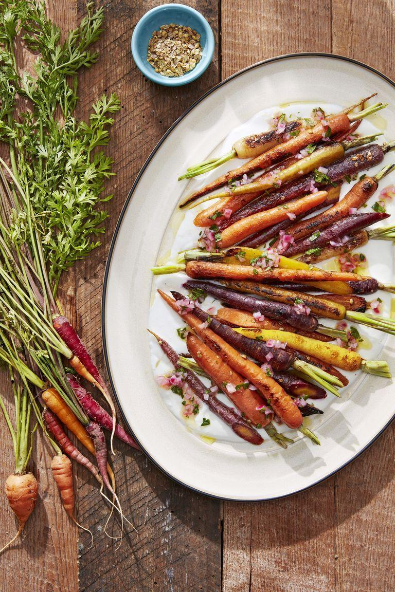 """<p>Add some color to the dinner table with these easy, yet delicious, roasted carrots.</p><p><strong><a href=""""https://www.countryliving.com/food-drinks/a28609650/coriander-roasted-carrots-recipe/"""" rel=""""nofollow noopener"""" target=""""_blank"""" data-ylk=""""slk:Get the recipe"""" class=""""link rapid-noclick-resp"""">Get the recipe</a>.</strong></p>"""