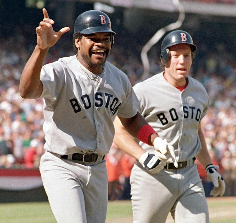 Dave Henderson, left, and Rich Gedman of the Boston Red Sox cheer after Henderson's ninth-inning homer.
