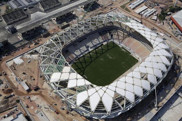 In this Dec. 10, 2013 photo, an aerial view of the Arena da Amazonia stadium in Manaus, Brazil. The construction firm building the Arena da Amazonia stadium which will host World Cup games in the jungle city of Manaus says a worker fell to his death Saturday from the stadium's roof structure. The Andrade Gutierrez company says Marcleudo Ferreira fell some 115 feet. (AP Photo/Renata Brito)