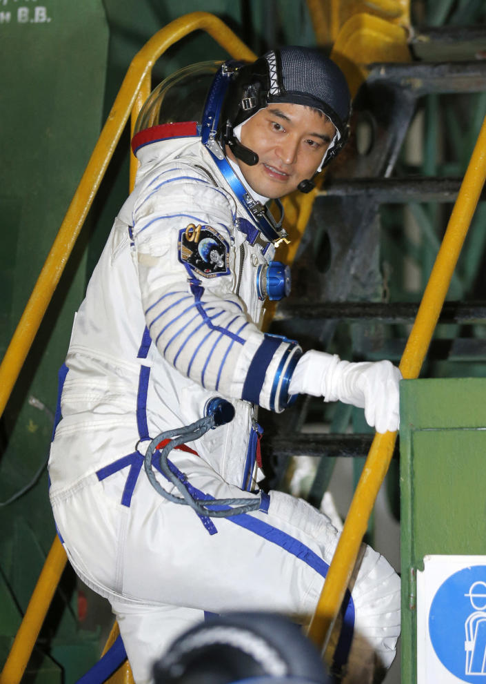 <p>Japanese astronaut Takuya Onishi, member of the main crew of the mission to the International Space Station (ISS), boards to the rocket prior the launch at the Russian leased Baikonur cosmodrome, Kazakhstan, Thursday, July 7, 2016. (AP Photo/Dmitri Lovetsky, Pool) </p>