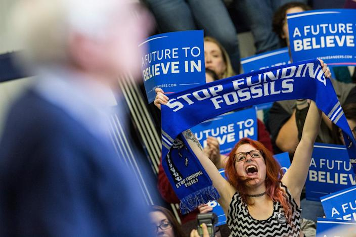 <p>Audience members cheer during a speech by Democratic presidential candidate Sen. Bernie Sanders at a campaign rally at Great Bay Community College in Portsmouth, on Feb. 7, 2016. Sanders is hoping to win the New Hampshire Democratic primary on Tuesday.<i> (Photo: Andrew Burton/Getty Images)</i></p>