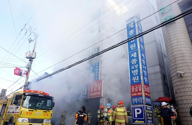 <p>Firefighters inspects a burnt hospital after a fire on Jan. 26, 2018 in Miryang, South Korea. (Photo: Kyungnam Shinmun via Getty Images) </p>