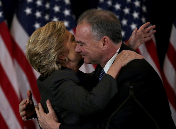 <p>Hillary Clinton embraces her running mate Tim Kaine as he arrives to address her staff and supporters about the results of the U.S. election at a hotel in the Manhattan borough of New York, November 9, 2016. (REUTERS/Carlos Barria) </p>