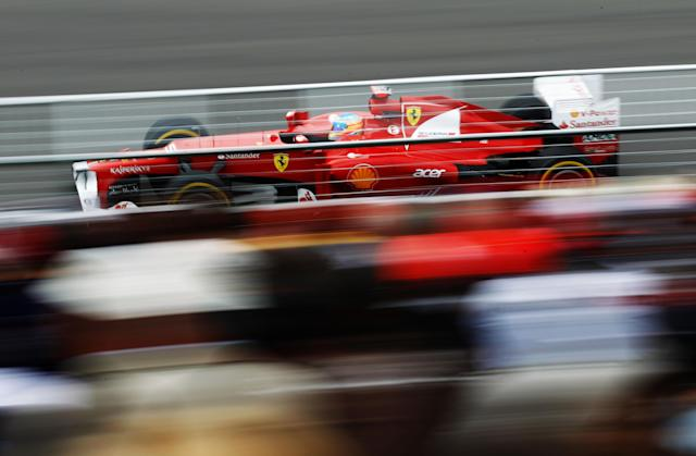 MONTREAL, CANADA - JUNE 08: Fernando Alonso of Spain and Ferrari drives during practice for the Canadian Formula One Grand Prix at the Circuit Gilles Villeneuve on June 8, 2012 in Montreal, Canada. (Photo by Paul Gilham/Getty Images)