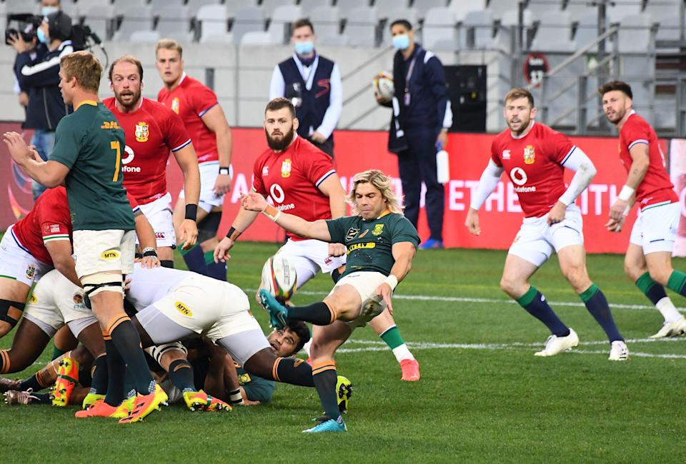 Faf de Klerk kicks the ball during the first Test with the Lions (AFP)