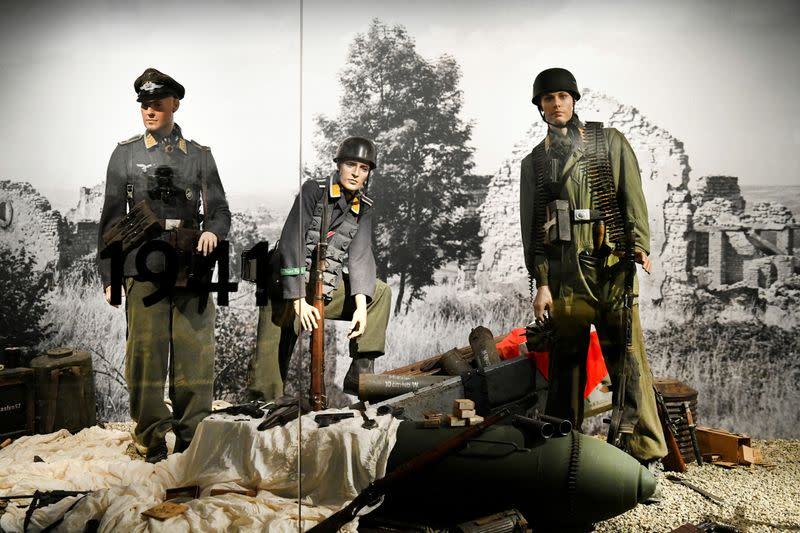German uniforms, helmets and weapons are displayed behind armoured glass at the Warmuseum Overloon in Overloon