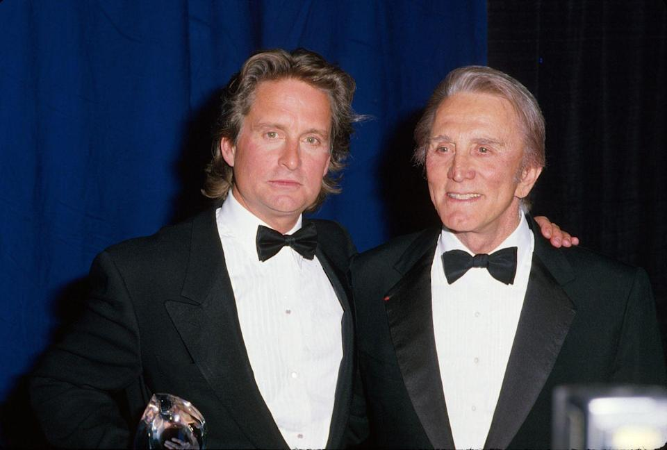 <p>Kirk poses with his son Michael, who followed in his father's footsteps into acting.</p>