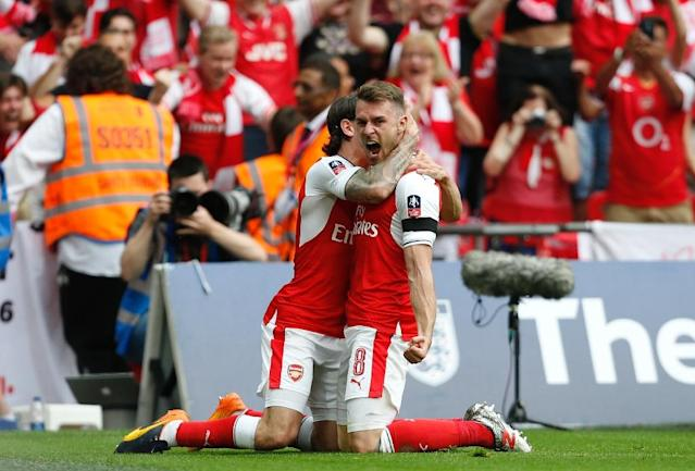 Arsenal's Aaron Ramsey (R) celebrates with teammate Hector Bellerin after scoring their second goal against Chelsea in English FA Cup final at Wembley stadium in London on May 27, 2017 (AFP Photo/Ian KINGTON)
