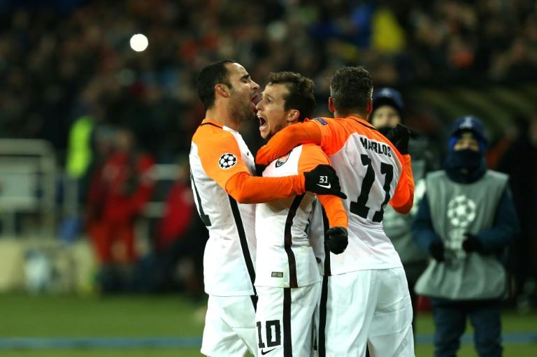 Shakhtar Donetsk's midfielder Bernard (C) celebrates with his teammates after scoring against Manchester City on December 6, 2017