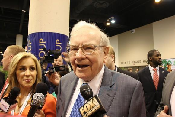 Warren Buffett walking through an investor conference.