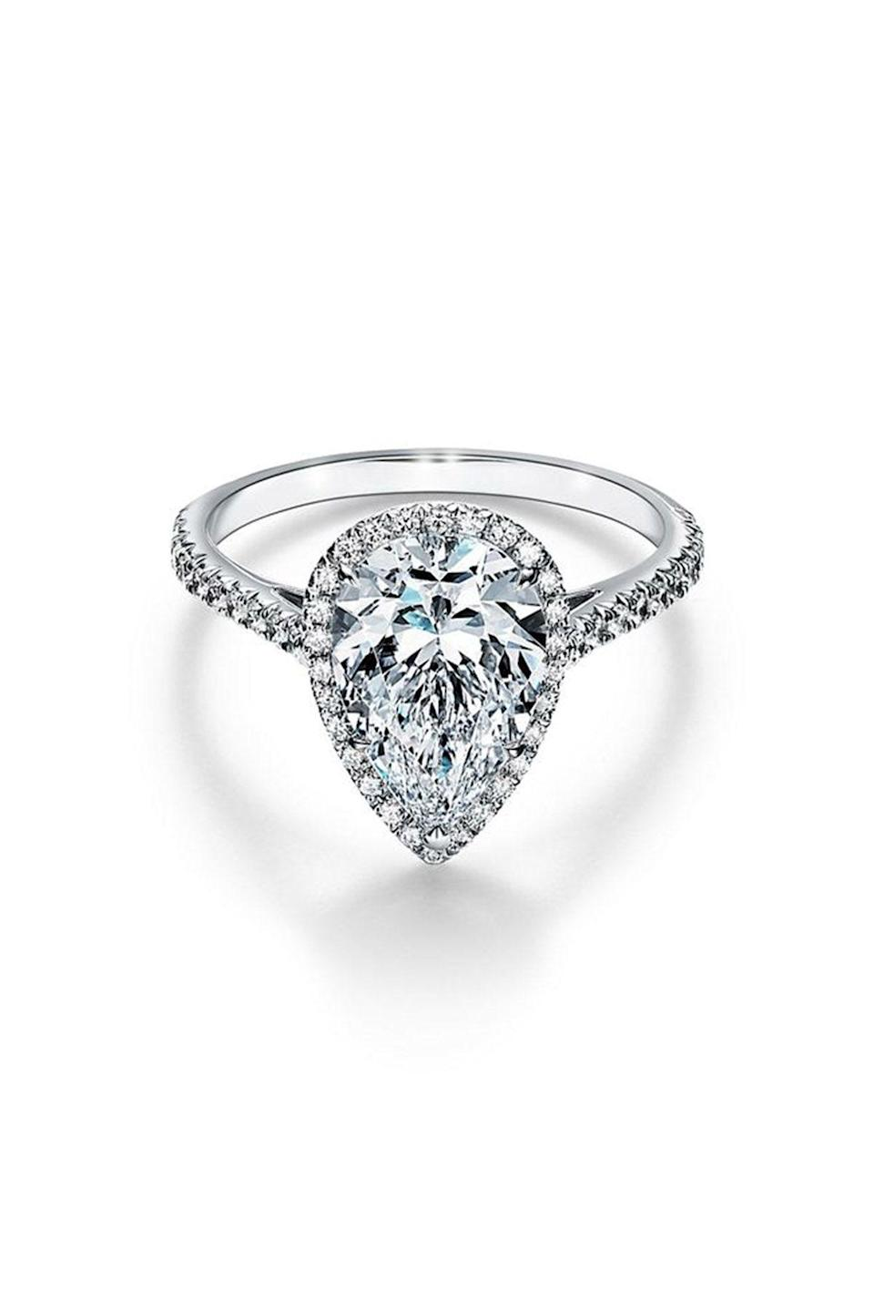 """<p><strong>Tiffany & Co.</strong></p><p>tiffany.com</p><p><a href=""""https://www.tiffany.com/engagement/engagement-rings/tiffany-soleste-pear-shaped-halo-engagement-ring-with-a-diamond-platinum-band-GRP10888/"""" rel=""""nofollow noopener"""" target=""""_blank"""" data-ylk=""""slk:Shop Now"""" class=""""link rapid-noclick-resp"""">Shop Now</a></p><p>Tiffany & Co is famous for their engagement rings and this pear-shaped halo lives up to the hype.</p>"""