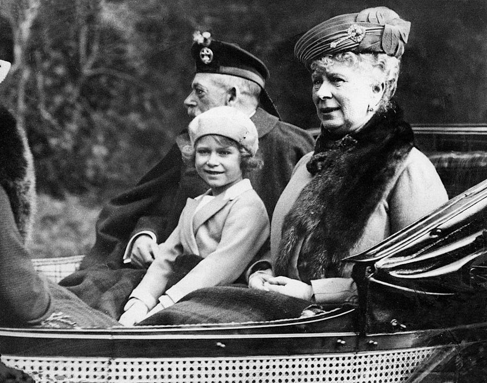 <p>Just a few years later, Elizabeth was photographed with her grandparents again at Balmoral. Here they are taking a carriage ride to Sunday church services. </p>