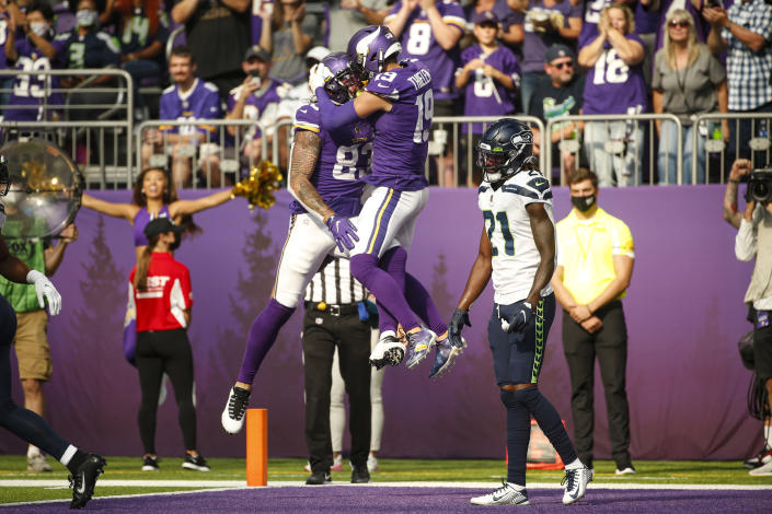 Minnesota Vikings tight end Tyler Conklin (83) celebrates with wide receiver Adam Thielen (19) after scoring a touchdown against the Seattle Seahawks in the first half of an NFL football game in Minneapolis, Sunday, Sept. 26, 2021. (AP Photo/Bruce Kluckhohn)