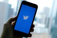 FILE PHOTO: The Twitter App loads on an iPhone in this illustration photograph