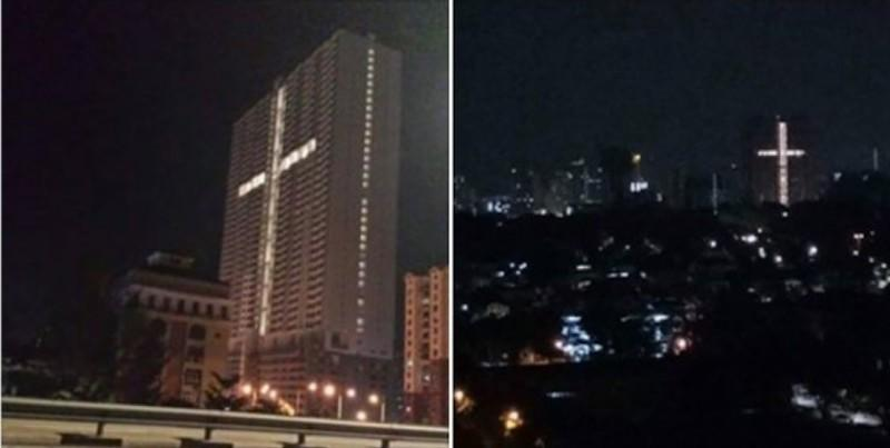 An image of a cross formed by lights in a building in Jelutong has caused consternation among some residents in the surrounding area. — Composite via Facebook
