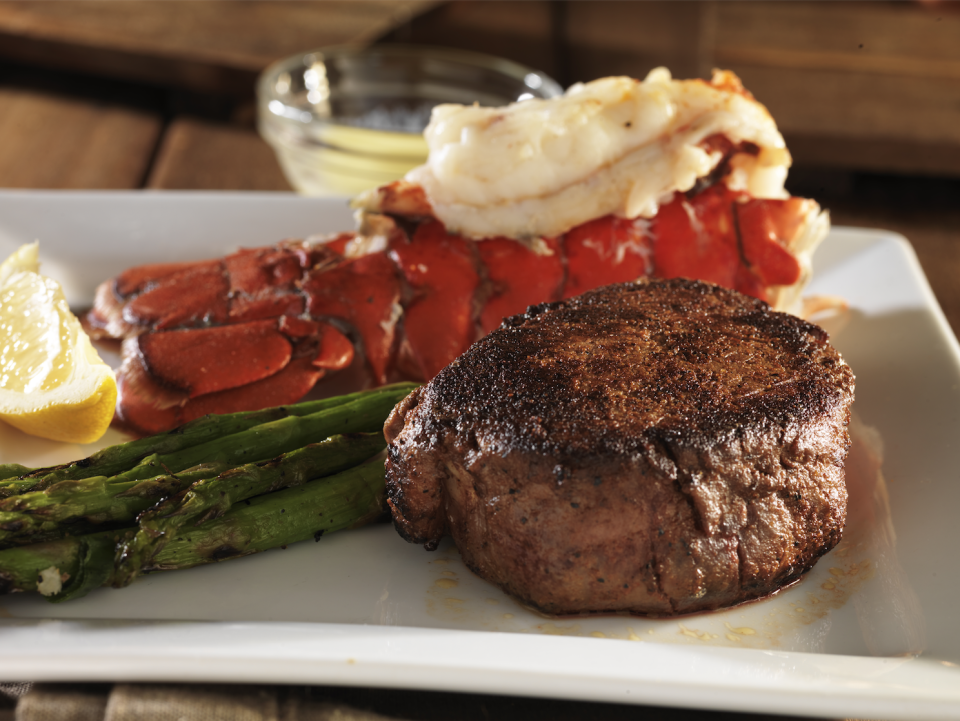 """<p>mychicagosteak.com</p><p><strong>$99.95</strong></p><p><a href=""""https://go.redirectingat.com?id=74968X1596630&url=https%3A%2F%2Fwww.mychicagosteak.com%2Fsurf-and-turf-cold-water-lobster-tails-and-usda-prime-steaks%2Fsurf-turf-pscs01.html&sref=https%3A%2F%2Fwww.townandcountrymag.com%2Fleisure%2Fdining%2Fg23937264%2Fgourmet-food-gifts%2F"""" rel=""""nofollow noopener"""" target=""""_blank"""" data-ylk=""""slk:Shop Now"""" class=""""link rapid-noclick-resp"""">Shop Now</a></p><p>What's better than a surf and turf dinner on the town? A ready-to-grill dinner of Premium Angus Beef filet mignons, sirloins, or New York strip steaks paired with 6 oz lobster tails ready to grill up in the privacy of your own home. </p>"""