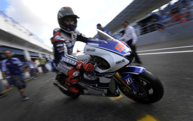 Yamaha Factory Racing team's Spanish rider Jorge Lorenzo leaves the pits during the Moto GP free practice 3 of the Portuguese Grand Prix in Estoril, outskirts of Lisbon, on May 5, 2012. AFP PHOTO / MIGUEL RIOPAMIGUEL RIOPA/AFP/GettyImages