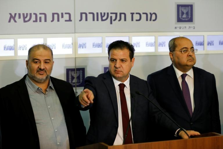 Joint List head Ayman Odeh (C) speaks to the press in the presence of Ahmad Tibi (R) and Mansour Abbas (L) following a meeting with Israel's president (AFP Photo/MENAHEM KAHANA)