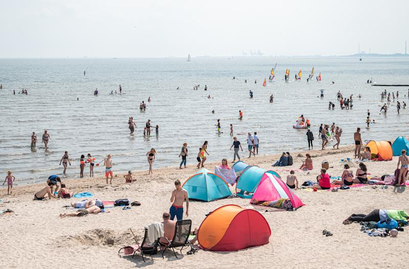 18 July 2020, Lower Saxony, Schillig: Numerous beach visitors are at summery temperatures on the North Sea beach of Schillig. Photo: Mohssen Assanimoghaddam/dpa (Photo by Mohssen Assanimoghaddam/picture alliance via Getty Images)