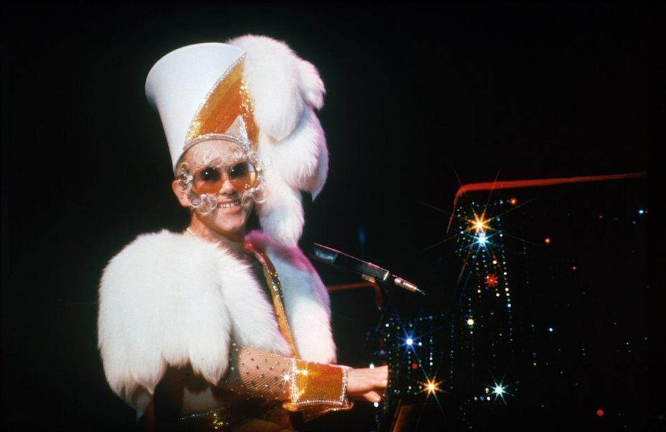 <p>Elton John performs at the Forum in Inglewood, Calif., on October 3, 1974, wearing a furry number. (Photo by Ed Caraeff/Getty Images) </p>