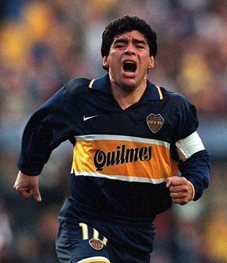 FILE - In this Oct. 25, 1997 file photo, Diego Armando Maradona celebrates a goal on his last official soccer game with Boca Juniors in Buenos Aires, Argentina.The Argentine soccer great who was among the best players ever and who led his country to the 1986 World Cup title before later struggling with cocaine use and obesity, died from a heart attack on Wednesday, Nov. 25, 2020, at his home in Buenos Aires. He was 60. (AP Photo/Eduardo Di Baia, File)