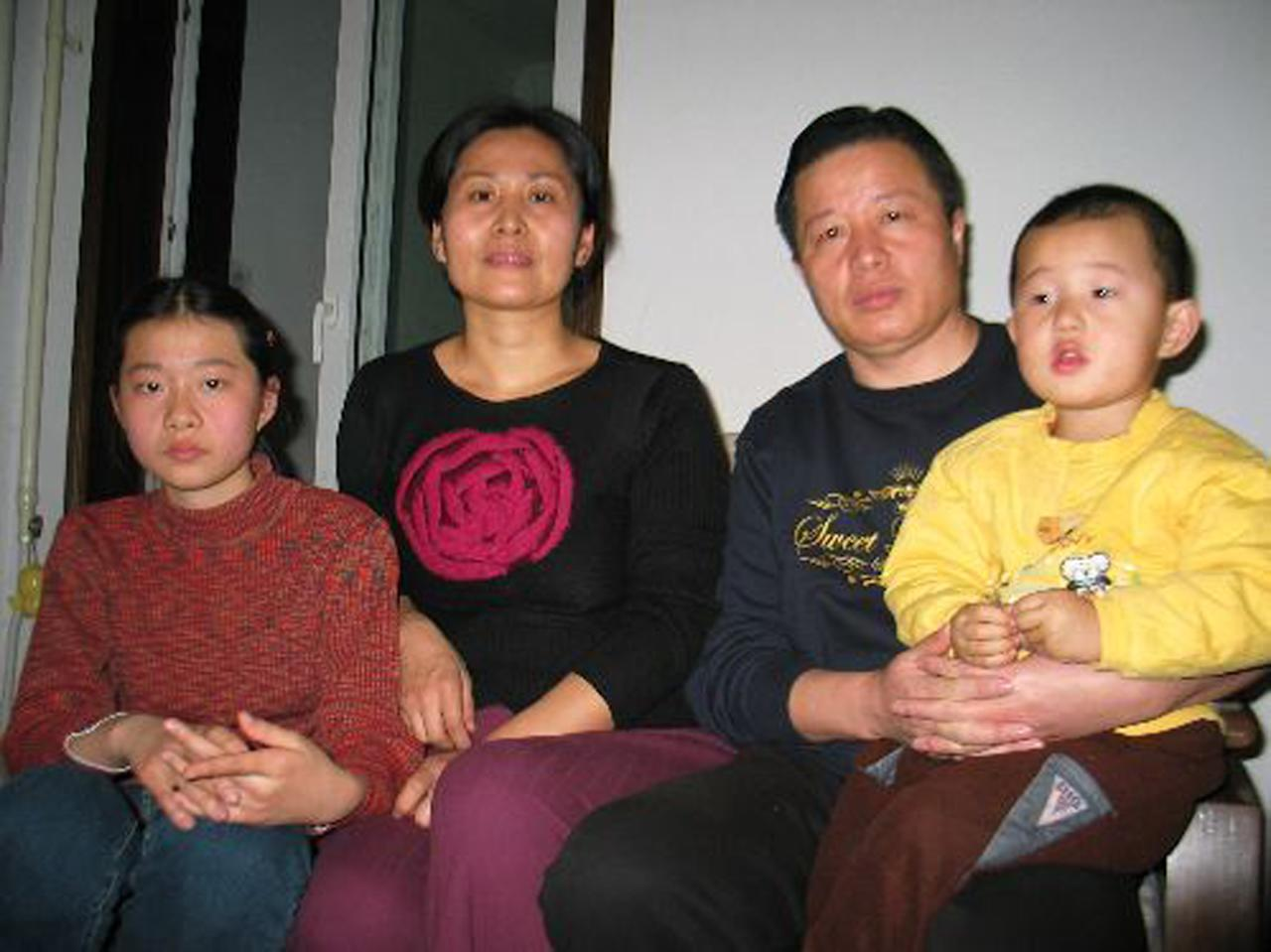 FILE - In this file photo taken Jan. 6, 2006 and released by Hu Jia, Gao Zhisheng, a human rights lawyer, second from right, poses for photos with his son Gao Tianyu, right, and his wife Geng He, second from left, and daughter Geng Ge, left, at their home in Beijing, China. An activist said Gao, one of China's best-known rights lawyers and fiery government critic ,has been released from prison but appears to be under close supervision by the authorities. Hu Jia said Gao was freed Thursday, Aug. 7, 2014, from a prison in a remote far-western county and is with his brother. (AP Photo/Hu Jia, File)