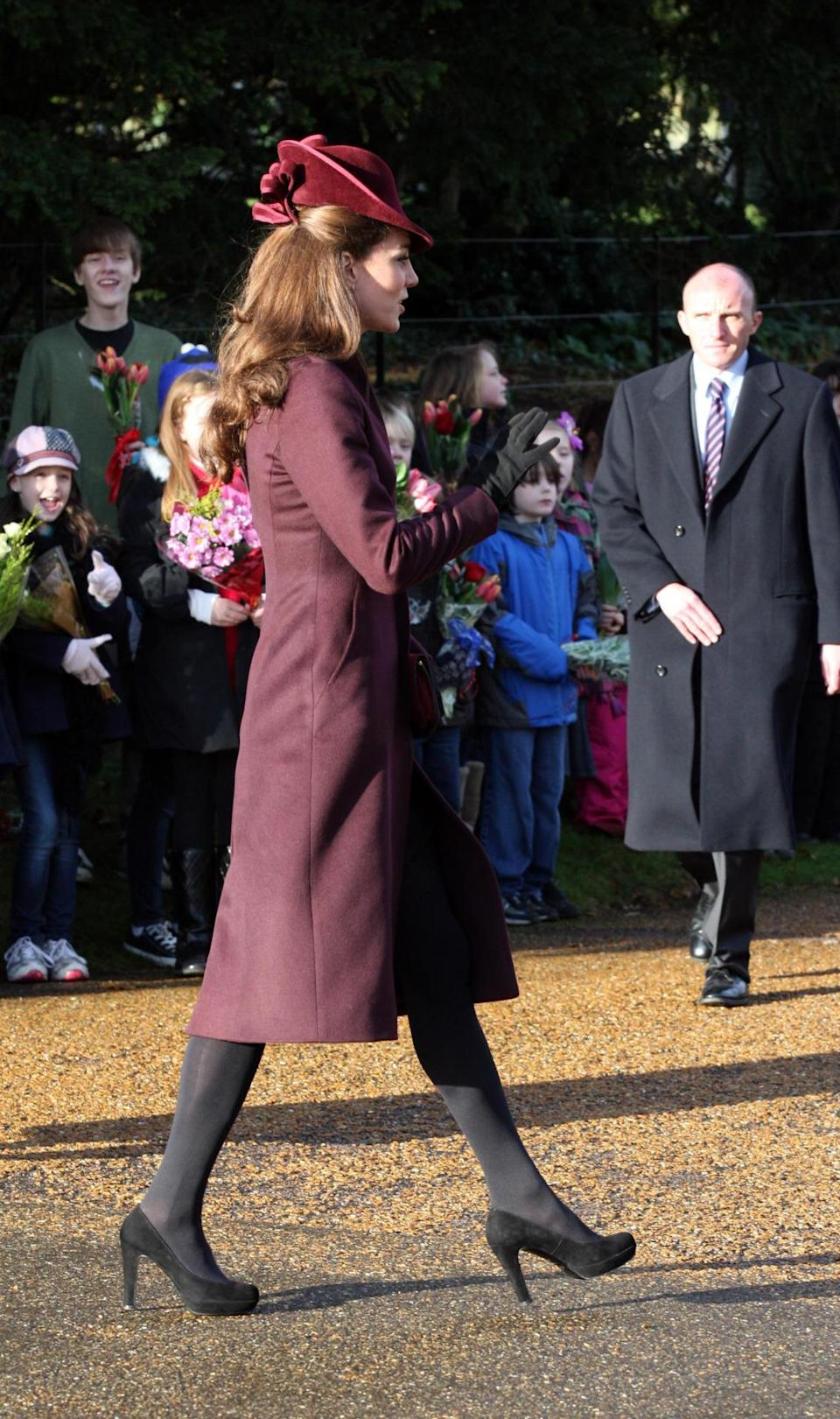 <p>The Duchess wore an aubergine coat made by an independent dressmaker for the Christmas Day service. She paired the look with a matching trilby created by Jane Corbett and black suede heels by Mascaro. </p><p><i>[Photo: PA]</i></p>