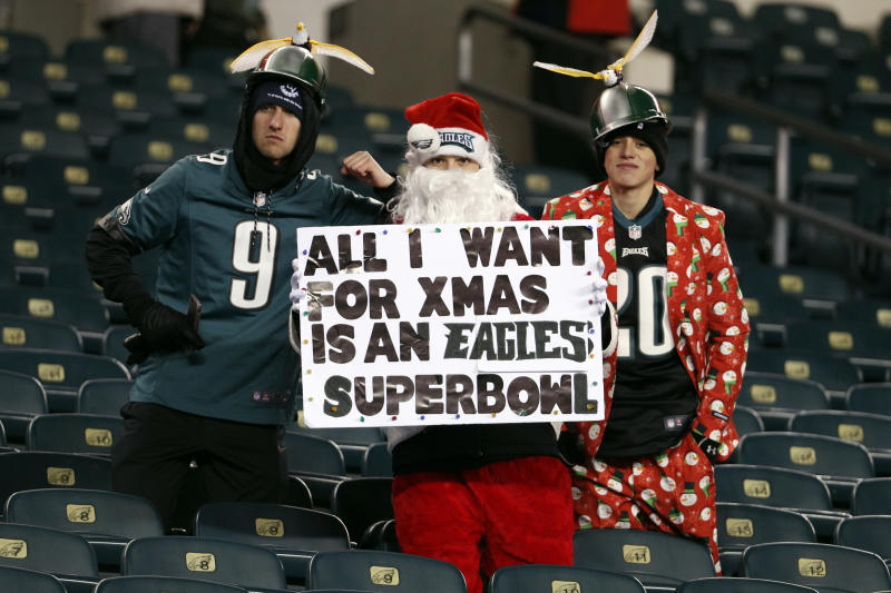 Philadelphia Eagles fans pose before a game against the Oakland Raiders on Christmas night. (AP)