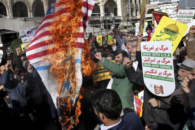 <p>Iranian worshippers burn representation of U.S. flag in a rally after Friday prayer in Tehran, Iran, Friday, Dec. 8, 2017. (Photo: Ebrahim Noroozi/AP) </p>