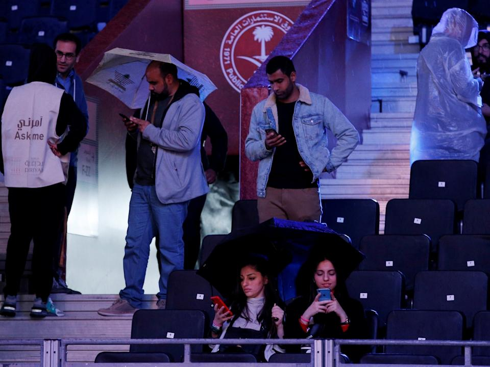 Fans attempt to remain dry ahead of Anthony Joshua vs Andy Ruiz: Reuters