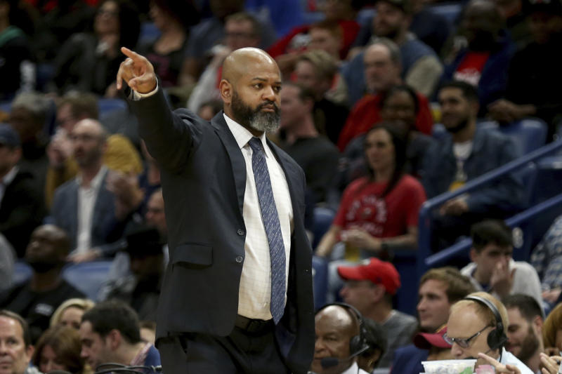 Cleveland Cavaliers coach J.B. Bickerstaff gives directions to his team during the first half of an NBA basketball game against the New Orleans Pelicans in New Orleans, Friday, Feb. 28, 2020. (AP Photo/Rusty Costanza)