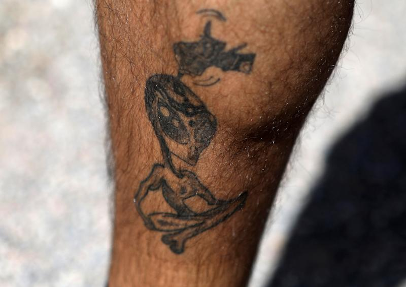 An attendee shows an alien themed tattoo as an influx of tourists responding to a call to 'storm' Area 51, a secretive U.S. military base believed by UFO enthusiasts to hold government secrets about extra-terrestrials, is expected in Rachel, Nevada, Sept. 19, 2019. (Photo: Jim Urquhart/Reuters)