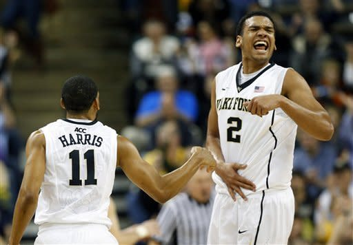 Wake Forest's Devin Thomas (2) celebrates after teammate C.J. Harris (11) made a three-point basket against Boston College during the second half of an NCAA college basketball game in Winston-Salem, N.C., Saturday, Jan. 12, 2013. Wake Forest won 75-72. (AP Photo/Chuck Burton)