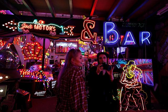 <p>People take pictures of neon signs and artworks in God's Own Junkyard gallery and cafe in London, Britain, May 13, 2017. (Photo: Russell Boyce/Reuters) </p>