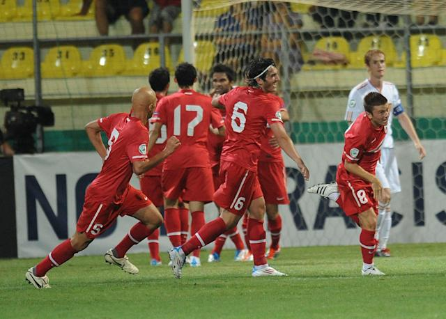 Gokay Iravul (R) of Turkey celebrates after he scored 3-0 for Turkey during football final tournament of UEFA European Under-19 Championship 2010/2011 in Chiajna village next to Bucharest July 26, 2011. Turkey won 3-0. AFP PHOTO/DANIEL MIHAILESCU (Photo credit should read DANIEL MIHAILESCU/AFP/Getty Images)