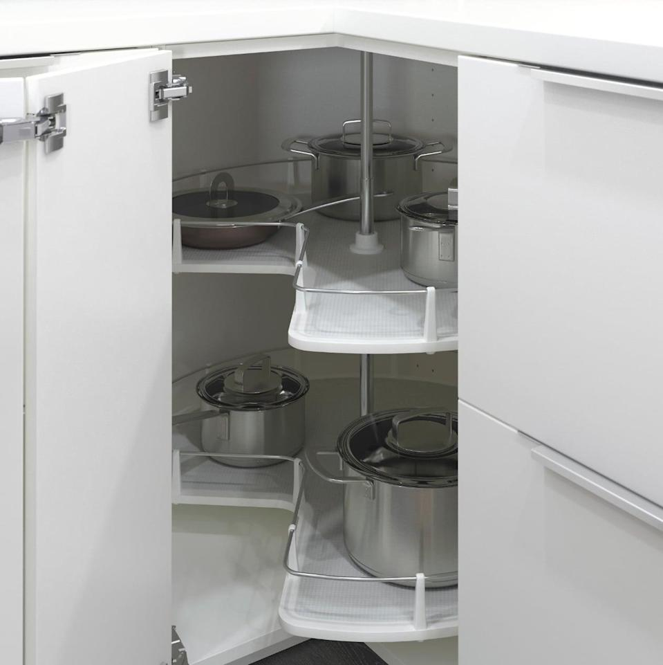 "<p>See and reach everything you need no matter how far back in the cupboard it is with the helpful <a href=""https://www.popsugar.com/buy/Utrusta%20Corner%20Base%20Cabinet%20Carousel-446974?p_name=Utrusta%20Corner%20Base%20Cabinet%20Carousel&retailer=ikea.com&price=99&evar1=casa%3Aus&evar9=46151613&evar98=https%3A%2F%2Fwww.popsugar.com%2Fhome%2Fphoto-gallery%2F46151613%2Fimage%2F46152159%2FUtrusta-Corner-Base-Cabinet-Carousel&list1=shopping%2Cikea%2Corganization%2Ckitchens%2Chome%20shopping&prop13=api&pdata=1"" rel=""nofollow noopener"" target=""_blank"" data-ylk=""slk:Utrusta Corner Base Cabinet Carousel"" class=""link rapid-noclick-resp"">Utrusta Corner Base Cabinet Carousel</a> ($99).</p>"