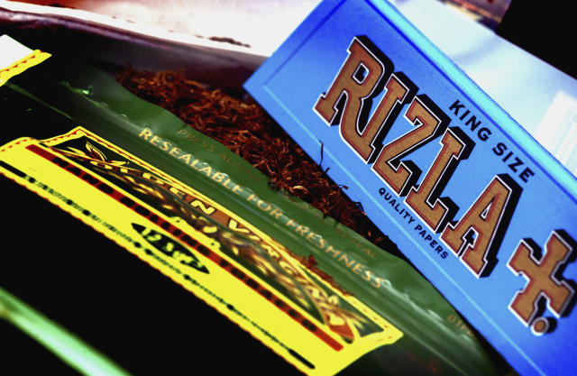 A packet of Rizla Blue cigarette papers and a pouch of Golden Virginia tobacco. (Newscast/Universal Images Group via Getty Images)