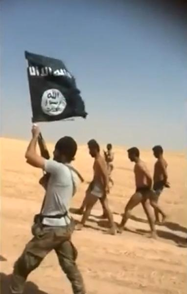 An image grab taken from a video uploaded on social networks on August 28, 2014, shows men in underwear being marched barefoot along a desert road before being allegedly executed on August 27, 2014 by Islamic State militants in Syria's Raqa Province (AFP Photo/)