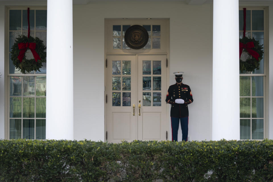 A Marine stands outside the entrance to the West Wing of the White House, signifying the President is in the Oval Office, Monday, Dec. 21, 2020, in Washington. (AP Photo/Evan Vucci)