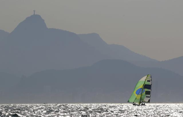 2016 Rio Olympics - Sailing - Preliminary - Men's Skiff - 49er - Race 7/8/9 - Marina de Gloria - Rio de Janeiro, Brazil - 15/08/2016. Marco Grael (BRA) of Brazil and Gabriel Borges (BRA) of Brazil compete with Corcovado Mountain in the background. REUTERS/Brian Snyder FOR EDITORIAL USE ONLY. NOT FOR SALE FOR MARKETING OR ADVERTISING CAMPAIGNS.