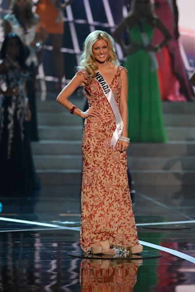 Miss Nevada Chelsea Caswell, from Las Vegas, Nev., walks the runway during the introductions of the Miss USA 2013 pageant, Sunday, June 16, 2013, in Las Vegas. (AP Photo/Jeff Bottari)