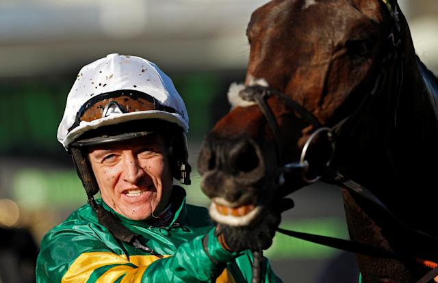 Horse Racing - Cheltenham Festival - Cheltenham Racecourse, Cheltenham, Britain - March 13, 2018 Barry Geraghty celebrates as he holds Buveur D'Air after winning the 15:30 Unibet Champion Hurdle Challenge Trophy Action Images via Reuters/Andrew Boyers