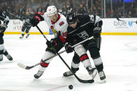 Ottawa Senators left wing Rudolfs Balcers, left, and Los Angeles Kings defenseman Sean Walker battle for the puck during the first period of an NHL hockey game Wednesday, March 11, 2020, in Los Angeles. (AP Photo/Mark J. Terrill)