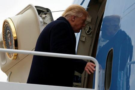 Trump boards Air Force One for travel to Kentucky from Joint Base Andrews, Maryland