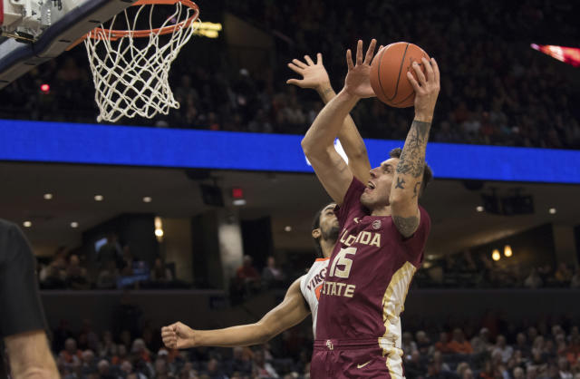 Florida State center Dominik Olejniczak (15) shoots as a Virginia player defends during the first half of an NCAA college basketball game in Charlottesville, Va., Tuesday, Jan. 28, 2020. (AP Photo/Lee Luther Jr.)