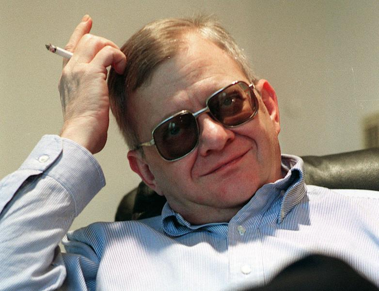 FILE - In this Feb. 4, 1998 file photo, writer Tom Clancy appears at his home in Calvert County, Md. Clancy, the bestselling author of more than 25 fiction and nonfiction books for the Penguin Group, died on Oct. 1, 2013 in Baltimore, Md. He was 66. (AP Photo/Vince Lupo)