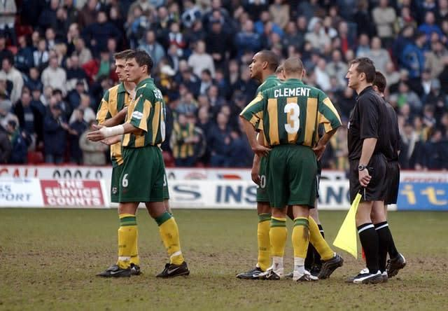 West Brom players react as referee Eddie Wolstenholme abandons the game (Paul Barker/PA)