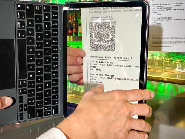 The SK Vax Verifier app helps businesses verify whether a patron is fully vaccinated or not by scanning QR codes provided through eHealth Saskatchewan.  (Matthew Howard/CBC - image credit)
