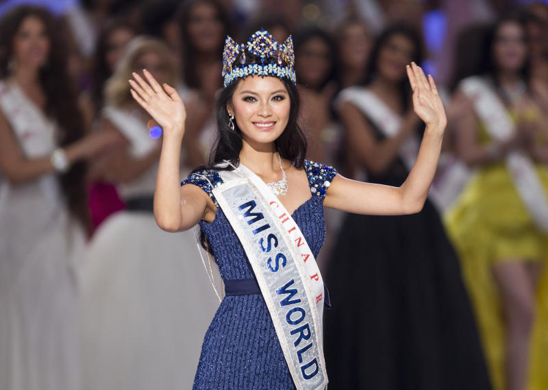 FILE - This Aug. 18, 2012 file photo shows newly-crowned Miss World Yu Wenxia, of China, after she won the Miss World 2012 beauty pageant at the Ordos Stadium Arena in inner Mongolia, China. Miss World has axed the famed bikinis from this year's pageant in Indonesia, replacing the skimpy swimsuits with conservative beach sarongs amid mounting protests from hard-line Muslim groups, organizers said Thursday, June 6, 2013. All of the more than 130 contestants will be required to wear Bali's traditional long sarongs instead of the sexy bikinis that are historically part of the competition, said Adjie S. Soeratmadjie of the RCTI, the official broadcaster and local organizer. (AP Photo/Andy Wong, file)